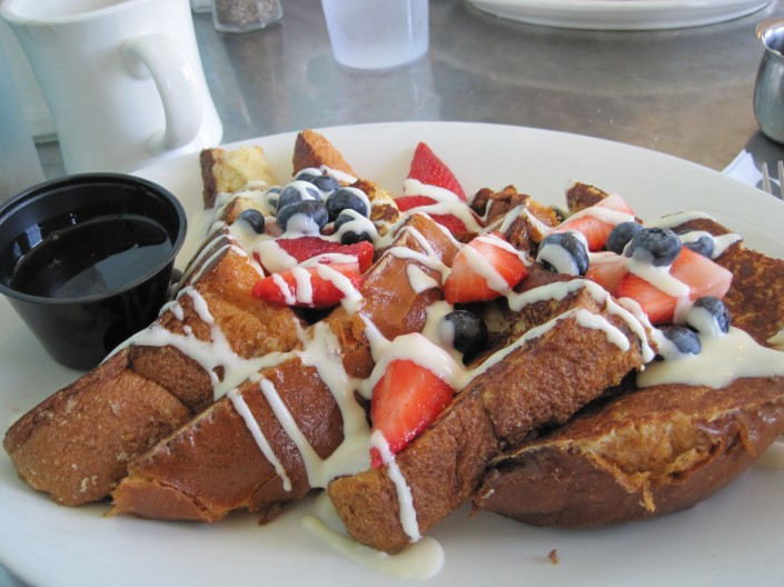 Challah bread french toast with berries, French cream, and brown sugar butter